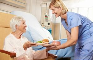 older-woman-and-nurse-with-plate-of-food